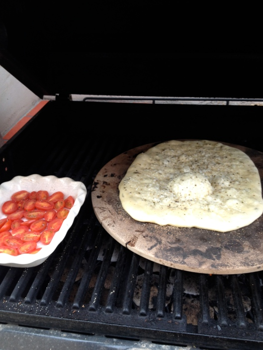grilling flatbread and tomatoes